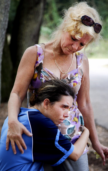 Sylvia Neeley, 48, comforts her daughter Jenny, 23, outside of the group home where Jenny now lives in Florida's Pasco County. Jenny clings tightly to her mother two days before Sylvia must report to her prison sentencing. Sylvia Neeley received a 10-year term for shooting Arthur Danner, a man she believed was molesting her mentally disabled daughter when she was 12.