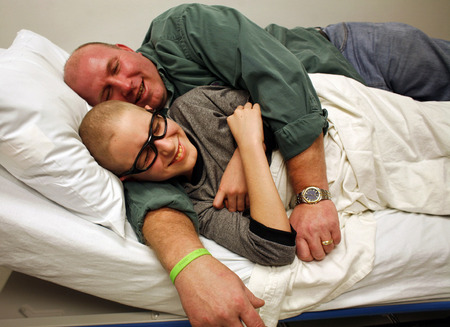 "David Salyer, top, and son Shane joke around during a seven-hour visit to St. Joseph's Hospital in Tampa, Fla, for Shane's cancer treatment. ""You never know what's going to happen,"" said David Salyer, who said Shane might have a clot in his heart."
