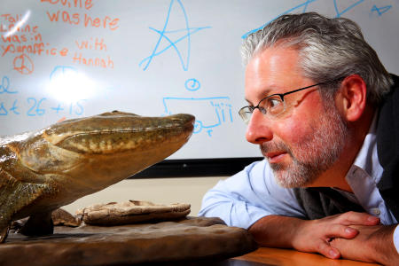 "Professor Neil Shubin, author of ""The Universe Within,"" is photographed in his office at the University of Chicago with his discovery Tiktaalik roseae."
