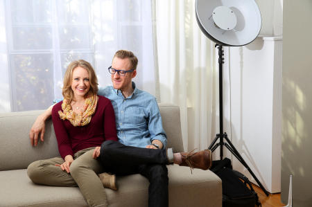 Anne and Steve Truppe sit in the Ravenswood apartment where they run their photography business, Tru Studio.