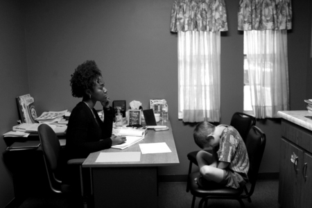Tia Cuyler, 26, left, works with Matthew during his speech therapy session.