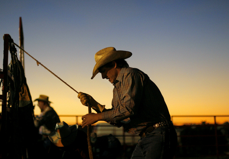 Alan Frierson, 24, warms up before competing in the bull riding competition in the 31st Annual Hernando County Rodeo and Barbeque Festival in Brooksville, Fla.