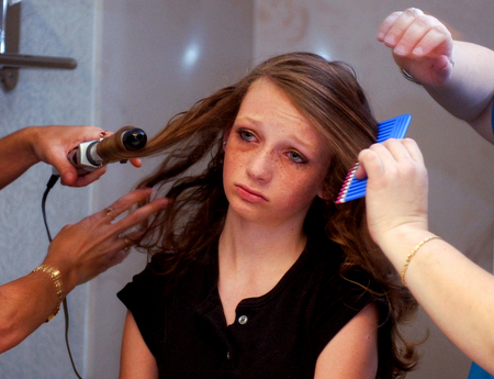"Molly Storts frowns as her mother tries to perfect the ""Barbie Flip"" moments before the 2005 Sweet Pea Pageants National Finals in Cocoa Beach.  ""Just fix it,"" said Storts."