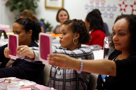 Laura Rodriguez, from left, Natalie Rodriguez, center, and Jessica Ocasio check out their makeup after receiving tips at  Mary Kay meeting.