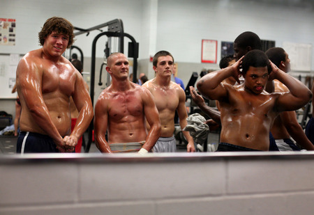 Charles Van Zandt, from left, Calvin Byerly, Jeremy Henderson and C.J. Bettis practice their poses in the weight room before the start of the ninth annual Mr. and Miss Wesley Chapel bodybuilding contest in Wesley Chapel, Fla.