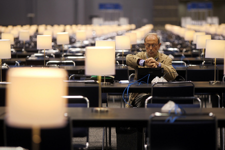An Italian journalist checks the time the day before the start of the 2012 NATO Summit in Chicago.
