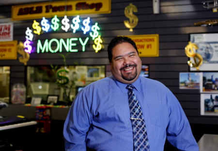 Jose Mejias, manager of A Able Pawners & Jewelers in Waukegan, poses inside his pawn shop.